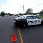 Springfield Police investigate a pedestrian who was struck and killed by a car on West Kearney Street on Tuesday, May 3, 2016.  The woman was struck by an eastbound vehicle when she was trying to cross the street.