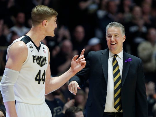 Purdue head coach Matt Painter shares a laugh with senior Isaac Haas as Haas comes out of the game late against Minnesota Sunday, February 25, 2018, at Mackey Arena. It was the final home game for Haas. Purdue defeated Minnesota 84-60.