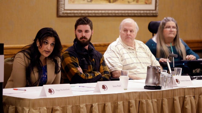 Attorney Simi Patel, left, is joined by plaintiffs, from left, Cameron Alderman, George Harris and Christine Seals at a press conference in Portland, Ore., Monday, Dec. 8, 2014. Sponsors of an Oregon ballot measure that would require labels on genetically modified foods filed a lawsuit today to force state elections officials to count 4,600 ballots disqualified because signatures on the vote-by-mail envelopes didn't match those on registration cards. (AP Photo/Don Ryan)