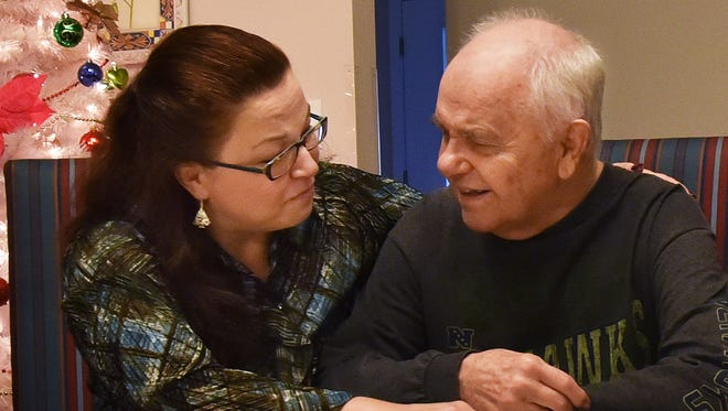Stephanie Hurd chats with her father, Paul Hensley, while visiting him at the Comfort Haven of Lacey memory care center in Lacey.