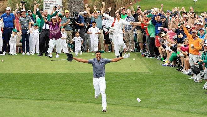 Tony Finau celebrates his hole-in-one on the seventh hole during the Par 3 Contest prior to the start of the 2018 Masters Tournament at Augusta National Golf Club on April 4, 2018 in Augusta, Ga.