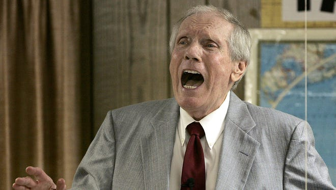 In this March 19, 2006, file photo, the Rev. Fred Phelps Sr. preaches at his Westboro Baptist Church in Topeka, Kan. Phelps, the founder of the Kansas church known for anti-gay protests and pickets at military funerals, died late Wednesday, March 19, 2014, his family said. He was 84.