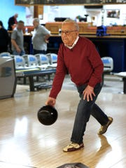 Sammy Manuele, 99, bowls at the Playdrome Bowling Alley in Toms River