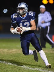 John Jay High School's Travis Contreras looks to make a move against Arlington in Wiccopee on Oct. 23.