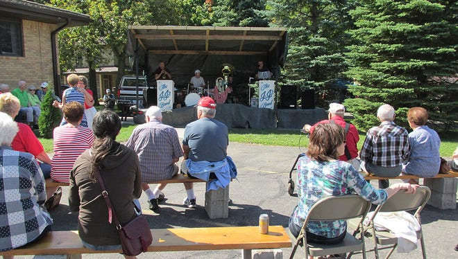 People enjoy live music at the St. Stephen Parish festival in September 2017 in St. Stephen.