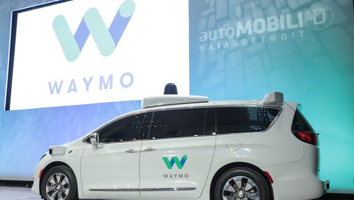 An self-driving hybrid Chrysler Pacifica minivan is