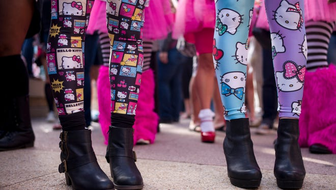 Hello Kitty fans wait in line for the Hello Kitty Con, the first ever Hello Kitty fan convention, held at the Geffen Contemporary at MOCA Thursday, Oct. 30, 2014, in Los Angeles.