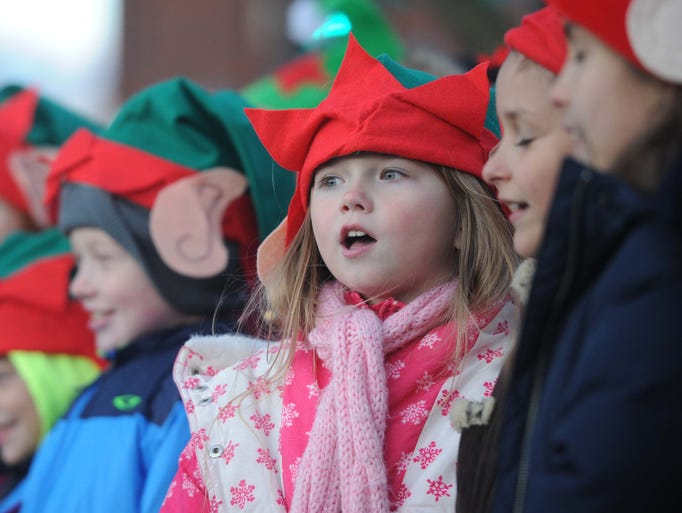 Isom Elementary School students sing at the event. The annual Greenwood-a-Glow Christmas Tree Lighting took place Saturday evening November 23, 2013 in downtown Greenwood.