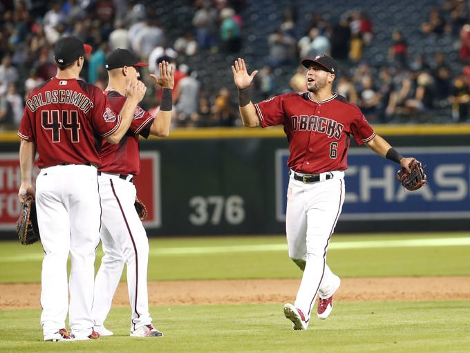 Arizona Diamondbacks' Paul Goldschmidt (44), Jake Lamb