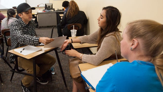 From left, Jesus Magaña, Angela Recancoj and Elizabeth Madden critique papers that they each wrote for an English composition class at the Ventura College East Campus in Santa Paula.