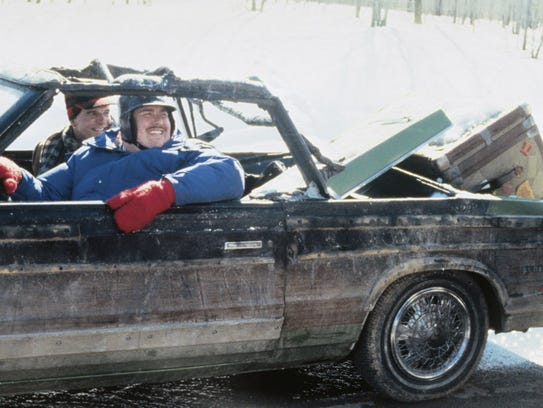 John Candy and Steve Martin film a scene in the burned-out
