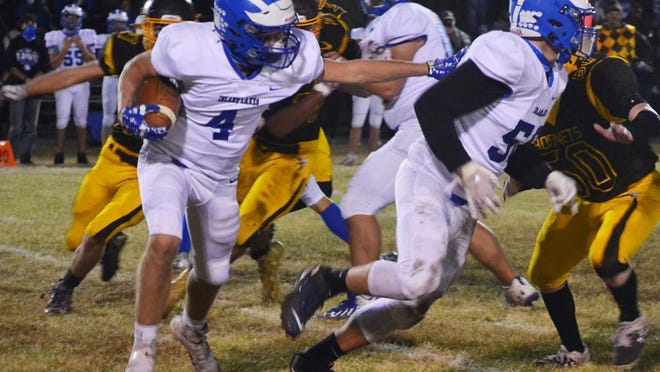 Inland Lakes senior Beau Vizina runs the ball during a recent MHSAA 8-Player football contest at Pellston. There's now a plan in place for the Inland Lakes football team to get their semifinal game in with Suttons Bay once the order is lifted by the state.