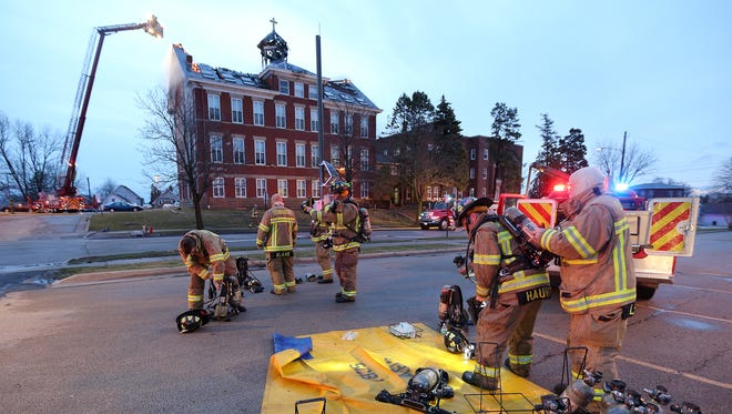 Dubuque firefighters battle a blaze at Visitation Hall at Loras College on Wednesday, March 16, 2016, in Dubuque, Iowa.