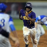 Hattiesburg's Devin Lang (28) runs to third base Tuesday during the Tigers' game against Ocean Springs at William Carey University.