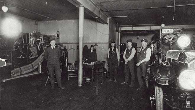 Fire chiefs are shown at the station house in Neenah city hall, circa 1920s.