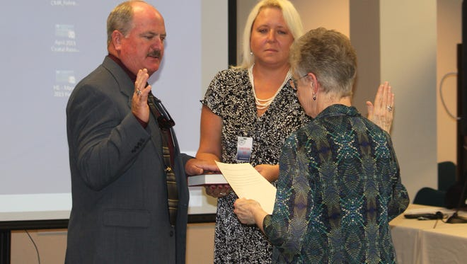 Ron Harmon takes the oath of office for the Mississippi Commission on Marine Resources.
