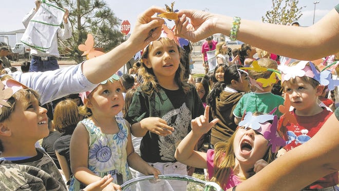 A special education class watches as butterflies are released at Desert Heights Elementary School in Stead.