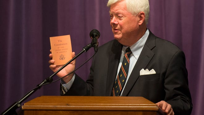 Pennsylvania Supreme Court Chief Justice Thomas Saylor  talks about the importance of the United States Constitution as he holds up a copy of the constitution at Lebanon Valley College on Friday, Sept. 16, 2016.