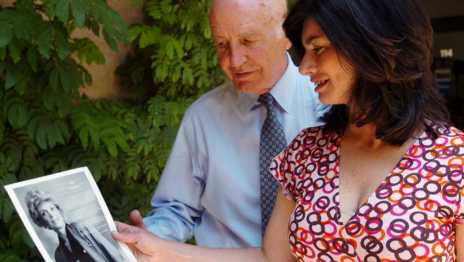 Marshall Gelfand and his daughter, Elizabeth Gelfand Stearns, look at a photo of the late Judy Gelfand. Marshall Gelfand died last week at 93 in Los Angeles.
