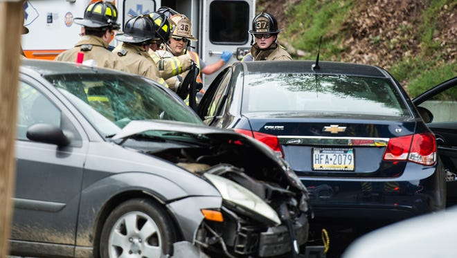 Emergency crews work to remove a woman from a car involved in a two-vehicle crash at Rt. 72 and Rt. 322 on Friday, June 16, 2017. Three people were transported to area hospitals and Rt. 72 was closed in both directions for about an hour.