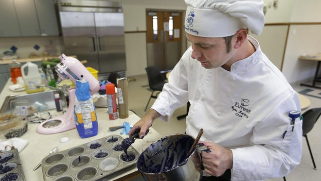 Chef Ryan Lanning makes cupcakes while volunteering Monday at Harbor House Domestic Abuse Services in Appleton. Lanning, whose sister was killed in a domestic incident in 2013, supports the annual Warrior Princess Mud Run, a major fundraiser for Harbor House.