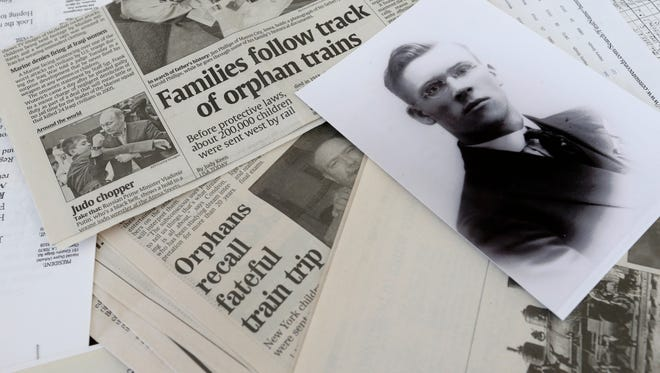 Carol Reinhardt of Neenah and her sister, Barb Thiel of Eau Claire, have saved photographs of their grandfather, Henry Smith, along with various documents and newspaper articles related to train orphans.