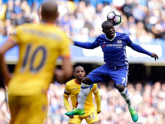 Chelsea's N'Golo Kante, right, heads the ball, during the English Premier League soccer match between Chelsea and Crystal Palace at Stamford Bridge stadium in London Saturday, April 1, 2017. (AP Photo/Alastair Grant)