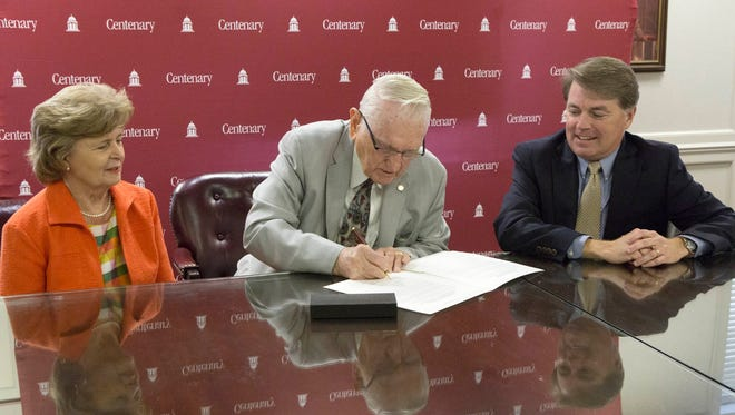 Wishy Nolan and David Rowe sign formal agreements establishing two new endowed scholarships.