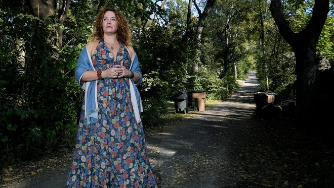 """Vali Forrister returns to an alley where on July 31,1989 she was raped. It's not the first time she has been back. On the 10th anniversary of the attack, Forrister went there with family and friends to """"reclaim the alley as sacred ground."""""""