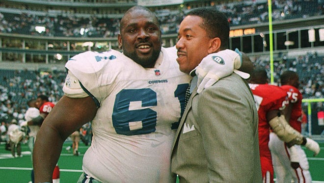 Bryan Burwell, then with USA TODAY, is embraced by Dallas Cowboys lineman Nate Newton in 1996. The former FAMU star is up for enshrinement in the Black College Football Hall of Fame.