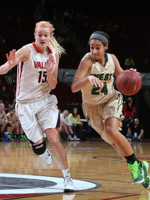 Iowa City West senior Mikaela Morgan drives the ball around Valley senior Grace Vander Weide on Friday, March 6, 2015, during the 5A girls semifinals at the 2014-15 Iowa girls basketball tournament in Des Moines, Iowa.