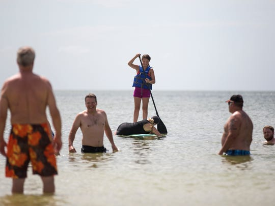 Beachgoers could be seen swimming, relaxing and hunting