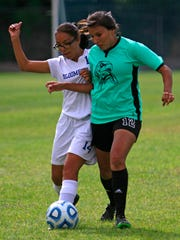 Bloomfield's Irene Castillo, left, and Navajo Prep's Naakii Brown battle for the ball on Aug. 26 at Mesa Alta Middle School in Bloomfield.