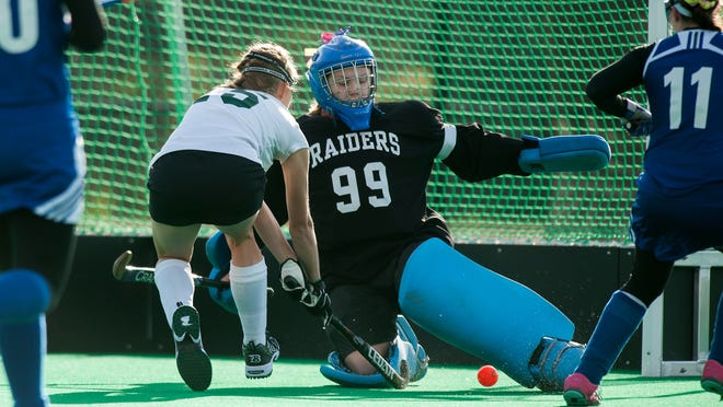 Rice's Sierra Combs (15) shoots the ball past U-32 goalie Bailee Hudson (99) for a goal during the Division II field hockey championship game earlier this month.