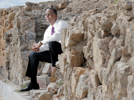 El Paso businessman Renard Johnson last week sat at the empty lot  at 617 W. Franklin  where he plans to build a high-end, two-story apartment complex. It's just down the street from the Downtown El Paso baseball stadium.