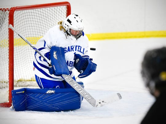 Sartell goalie Cole Bright blocks a shot against Warroad