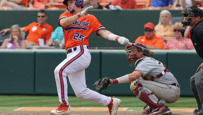 Chris Okey drives in one of his five runs in the Tigers' 10-3 victory over Florida State Saturday.