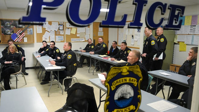 Officers ready themselves for their afternoon shift during roll call on Jan. 24, 2012 at the Green Bay Police Department. File/USA TODAY NETWORK-Wisconsin.