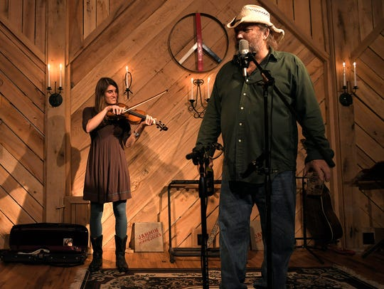 Jack Stoddart, right, introduces musician Lizzy Plotkin