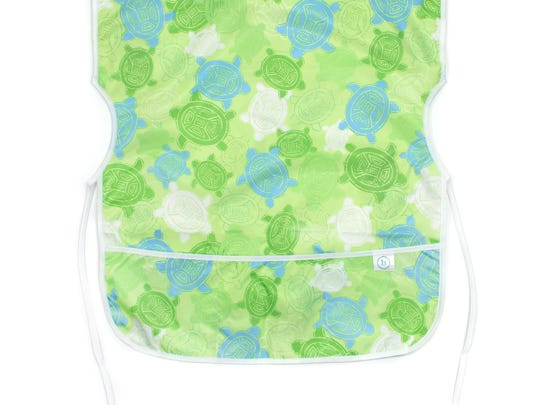 Pretty turtles and a pastel green background enhance this cute smock from Bumkins.