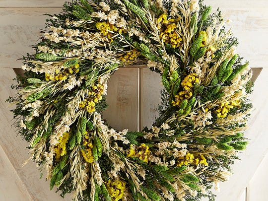 A door wreath is a fresh way to signal not just spring but fresh shades of green, from Pier 1.