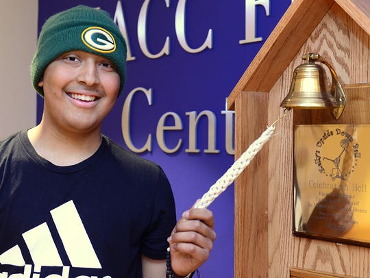 Thomas Harris rings the bell at the Children's Hospital