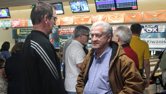 Livonia Mayor Dennis Wright speaks with Dave Rexroth, chief meteorologist at WXYZ-TV and celebrity bowler for the event.