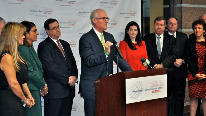 Westchester County Association Chairman William P. Harrington, center, flanked by WCA President Marissa Brett, right, and Jeffrey Menkes of Montefiore Medical Center, left, announced new health care initiatives Tuesday in White Plains.