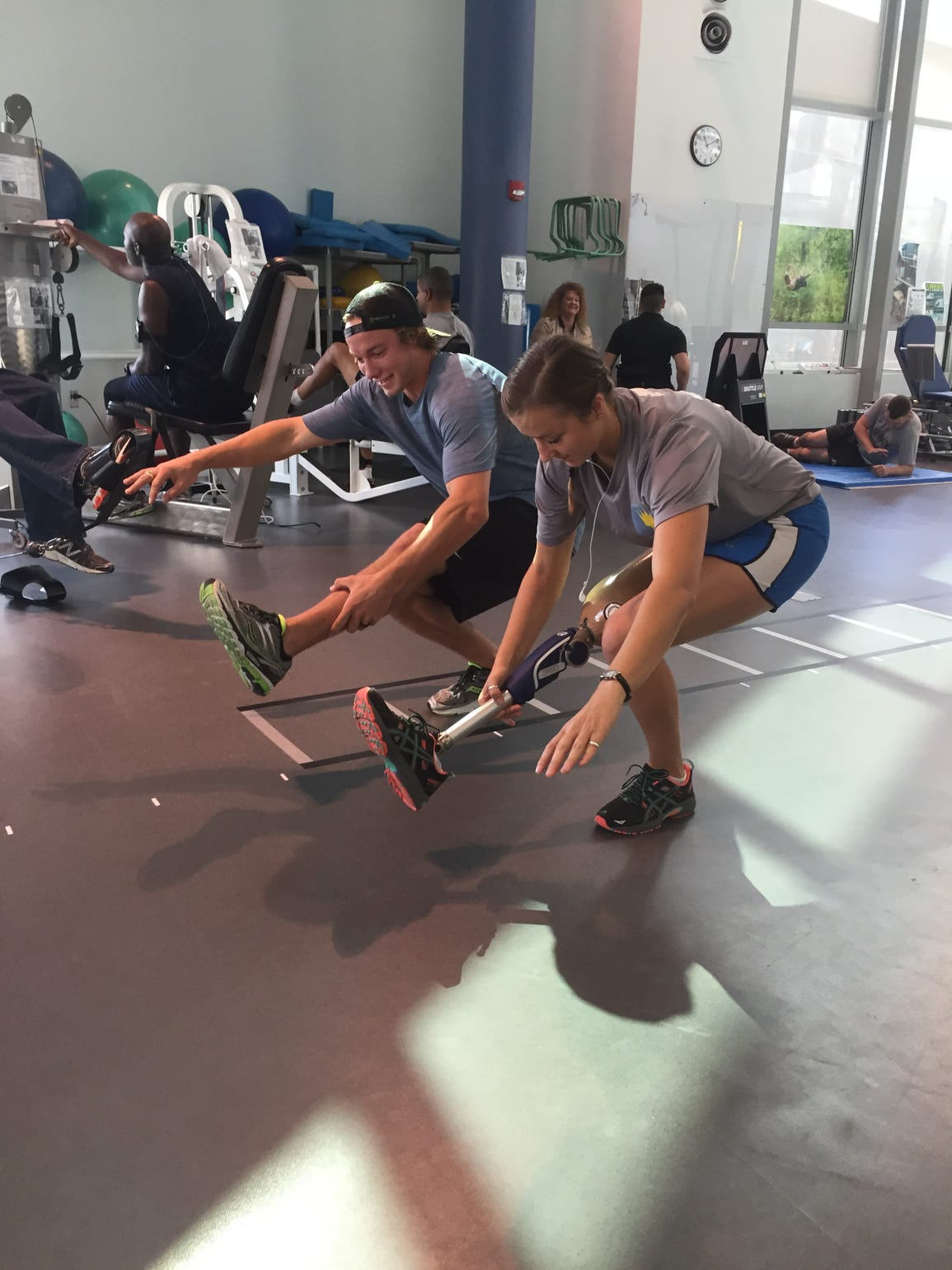 David, left, and Christy go through a workout following