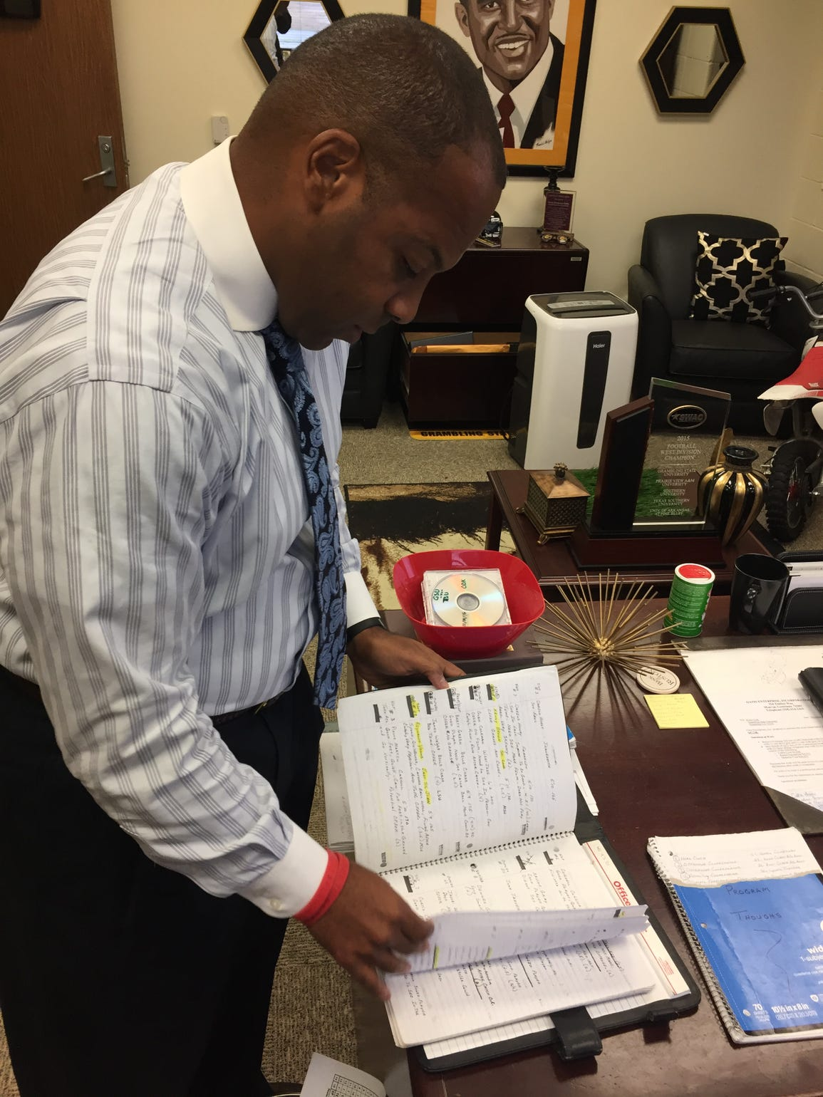 Grambling coach Broderick Fobbs combs through his old