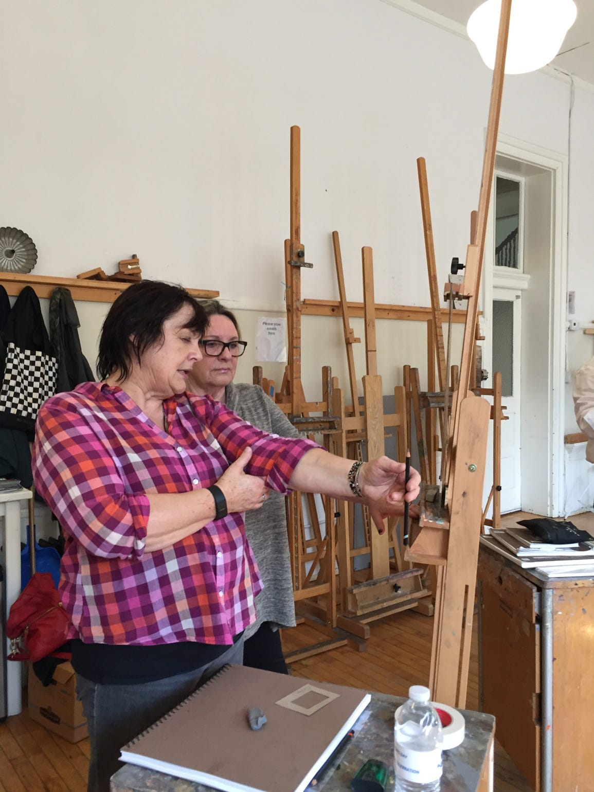 Art instructor Janly Jaggard teaches student Carolyn