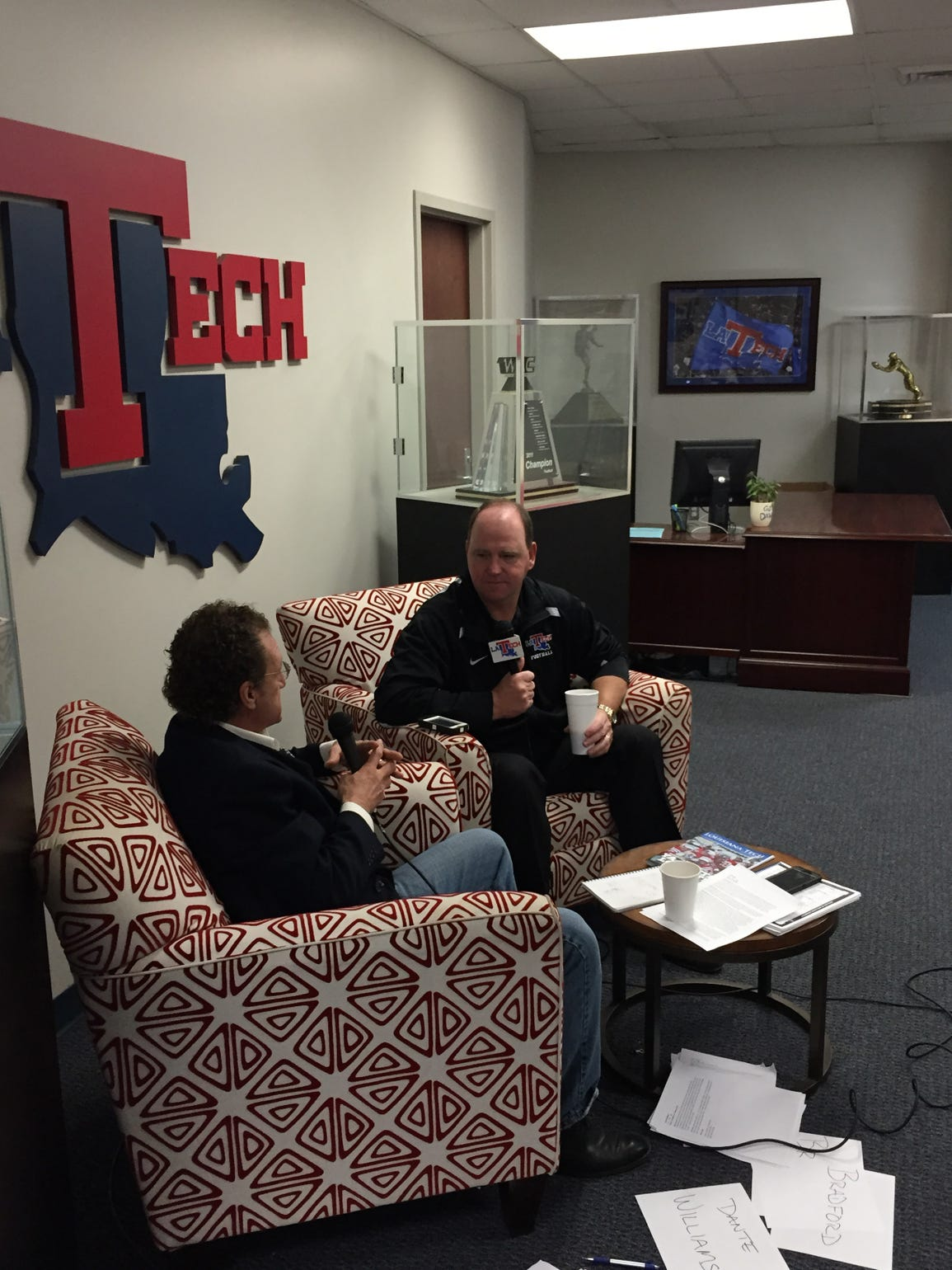 Louisiana Tech coach Skip Holtz, right, discusses signing