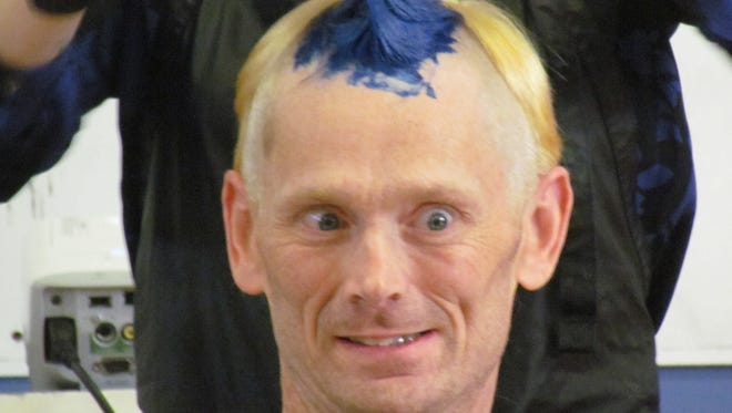 Stayton Elementary School students raised more than $7k for the American Heart Association through Jump Rope for Heart, prompting their PE teacher Chuck Larimer to get a colorful mohawk.