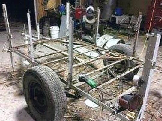 A picture of the popup camper trailer after it was stripped down to its original frame.